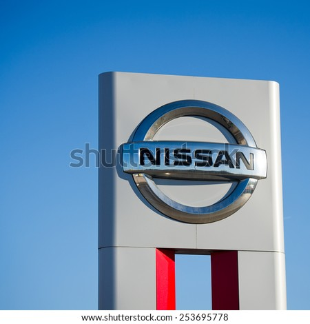 VILNIUS - FEB 17: Nissan dealership logo on Feb. 17, 2015, Vilnius, Lithuania. Nissan Motor Corporation is a Japanese multinational automobile manufacturer headquartered in Nishi-ku, Yokohama, Japan. - stock photo