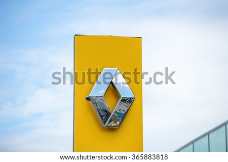 VILNIUS-JULY 3: Renault logo on July 3, 2014 in Vilnius, Lithuania. Renault S.A. is a French car manufacturer producing cars, vans, buses, trucks, tractors, tanks, buses/coaches and autorail vehicles. - stock photo