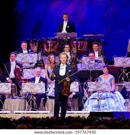 VILNIUS - JUN 3: ANDRE RIEU together with his 60-piece Johann Strauss Orchestra performs on stage in Siemens Arena on June 3, 2014 in Vilnius, Lithuania. Andre Rieu is a famous Dutch violinist. - stock photo