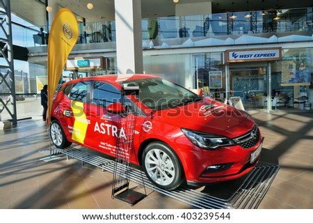 VILNIUS, LITHUANIA - APRIL 02, 2016: Demonstration of new model of the car Opel Astra in  largest shopping center Panorama. The producer gives a guarantee on the car of 4 years. Sunny spring morning - stock photo