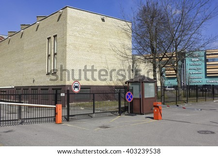VILNIUS, LITHUANIA - APRIL 02, 2016:  Empty car parking near biggest city Panorama sopping center.  Sunny spring morning - stock photo