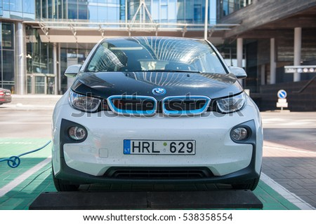 VILNIUS, LITHUANIA - AUG 6, 2015: Electric car BMW I3 charging its batteries. The BMW i3, previously Mega City Vehicle (MCV), is a five-door urban electric car developed by the German manufacturer BMW