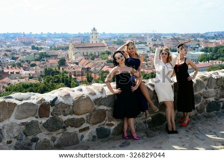 VILNIUS, LITHUANIA - AUGUST 23: Beautiful girls in Vilnius town Gediminas castle hill on August 23, 2015, Vilnius, Lithuania.