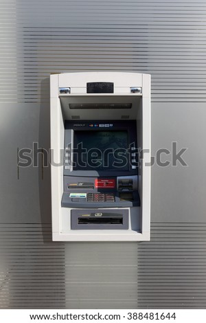 VILNIUS, LITHUANIA - FEBRUARY 07, 2016: The street ATM of production of Diebold brand is built in in a glass wall of DNB bank. Diebold and IBM created a general partnership called InterBold in 1991 - stock photo