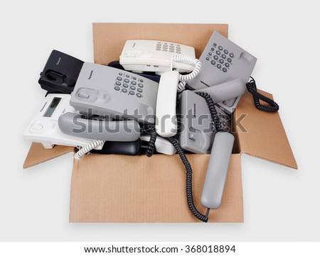 VILNIUS, LITHUANIA - JANUARY 25, 2016: A cardboard box with Panasonic cheap phones which are prepared for utilization and processing. Cost of one phone about 10 euros