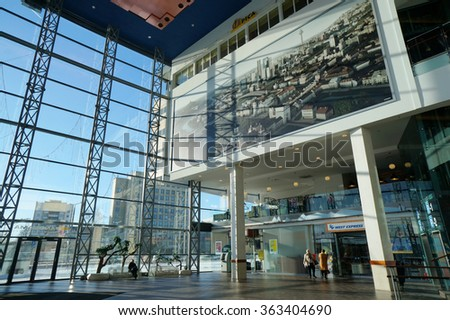 VILNIUS, LITHUANIA - JANUARY 16, 2016: Glass wall and huge photo of the city  in the largest market Panorama. Area of the center is more than 65 thousand square meters with 200 shops and restaurants  - stock photo