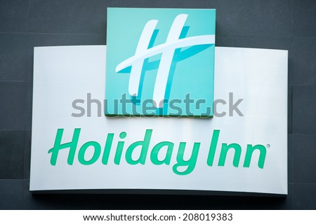 VILNIUS, LITHUANIA - JULY 10: Holiday Inn Hotel sign on July 10, 2014 in Vilnius, Lithuania. Holiday Inn is a multinational brand of hotels, part of the British InterContinental Hotels Group.