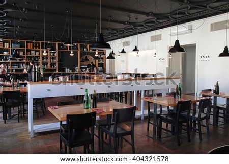 VILNIUS, LITHUANIA - JULY 21, 2015: The modern cafe with cozy interior and with open kitchen, Vilnius, Lithuania. - stock photo
