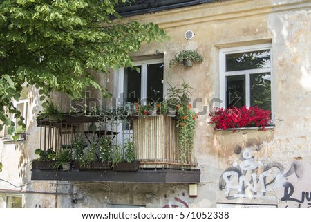 VILNIUS, LITHUANIA - June 11,2017: Beautiful windows and balcony decorated with flowers, Vilnius, Lithuania