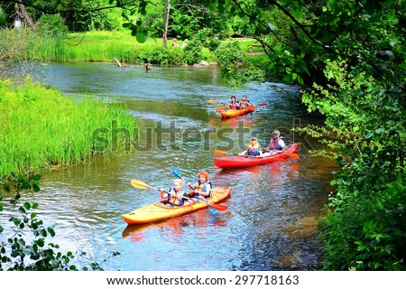 VILNIUS, LITHUANIA - JUNE 28: Canoes in River Vilnele near Entertainment and Recreation Center Belmontas on June 28, 2015, Vilnius, Lithuania.