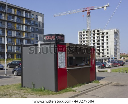 VILNIUS, LITHUANIA - JUNE 26, 2016: The booth of fast food  - the Turkish kebabs with meat and vegetables - is located in center of the new residential area of Lithuanian capital - Pilaite   - stock photo