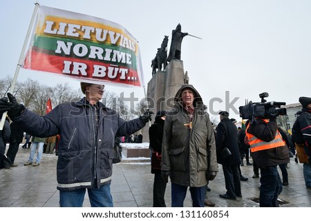 VILNIUS, LITHUANIA - MAR 11: Around one thousand people gathered with flags in a nationalist rally at Gedimino Avenue in central Vilnius on Re-Establishment of Independence Day on March 11, 2013.