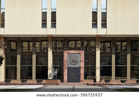 "VILNIUS, LITHUANIA - MARCH 27, 2016: Central metal door of an entrance to  "" Seimas"" (parliament)  of the republic Lithuania. Parliamentarians have a rest. Solar quiet Easter morning"