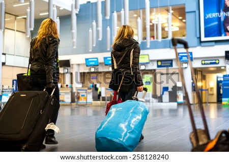 VILNIUS, LITHUANIA - MARCH 05: People going to security control in Vilnius Airport on March 5, 2015, Vilnius, Lithuania - stock photo
