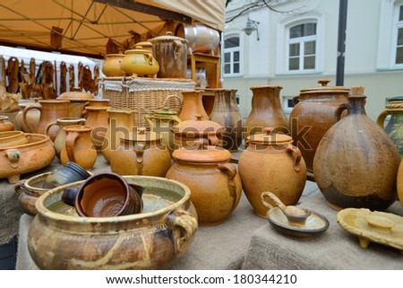 VILNIUS, LITHUANIA - MARCH 7: Typical lithuanian pots in annual traditional crafts fair - Kaziuko fair on Mar 7, 2014 in Vilnius, Lithuania - stock photo