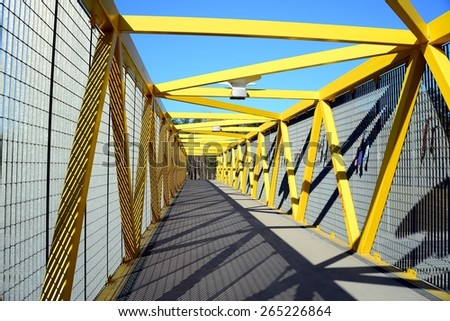 VILNIUS, LITHUANIA - MARCH 17: Walking bridge over bybass of Vilnius city in western side on March 17, 2015, Vilnius, Lithuania.