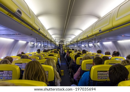 VILNIUS, LITHUANIA - MAY 2: Passenger compartment of the aircraft company Ryanair on 2 may 2014. Ryanair is one of the largest low-cost European airline by scheduled passengers carried.  - stock photo