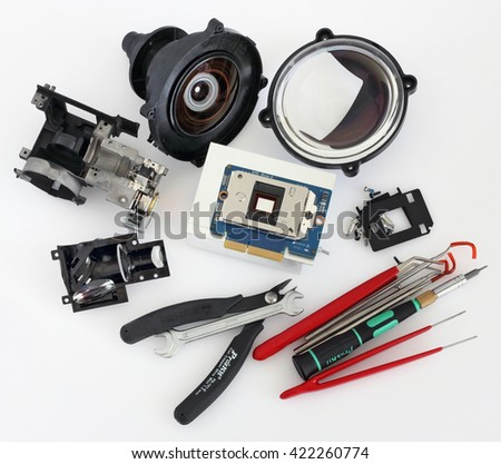 VILNIUS, LITHUANIA - MAY 17, 2016: Samsung brand projectors high technology optical parts on diagnostic table in professional repair center - stock photo