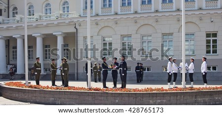 VILNIUS, LITHUANIA - MAY 29, 2016: Soldiers and seamen of armed forces and navy of the Republic of Lithuania prepare for solemn raising of national flags near the presidential palace