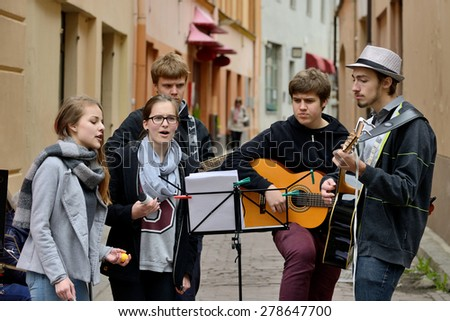 VILNIUS, LITHUANIA - MAY 16: Unidentified musician play guitar in Street music day on May 16, 2015 in Vilnius. Its a most popular event on May in Vilnius, Lithuania - stock photo