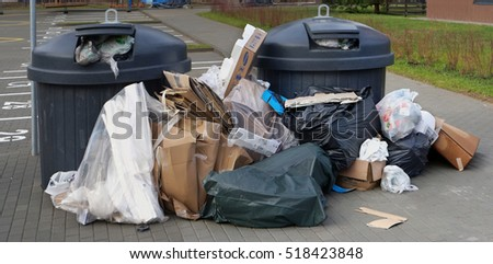 VILNIUS, LITHUANIA - NOVEMBER 19, 2016:  Municipal urban services can not cope with the garbage. Garbage overflowing cardboard, plastic and household waste