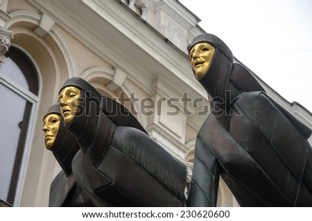 Vilnius, Lithuania on October 11, 2014 - The three Muses statues of the Lithuanian National Drama Theater on Gediminas Avenue. Was founded in 1940, and is the biggest in Lithuania - stock photo