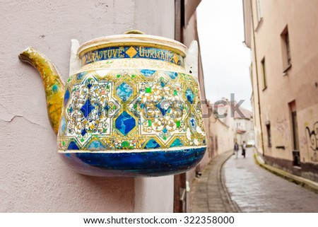 Vilnius, Lithuania - September 15, 2015: Colorful tea pot on a building wall in the old town of Vilnius.
