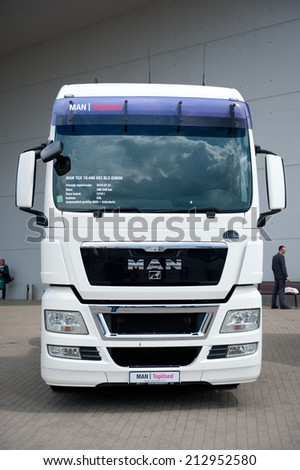 VILNIUS - MAY 9: MAN TGX 8.440 4x2 BLS truck on May 9, 2014 in Vilnius, Lithuania. MAN AG, is a German mechanical engineering company. MAN supplies trucks, buses, diesel engines and turbomachinery. - stock photo