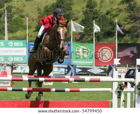 VIMEIRO, PORTUGAL - JUNE 6: Equestrian International Show Jumping 3* - Tiago Quintas (POR) June 6, 2010 in Vimeiro, Portugal - stock photo