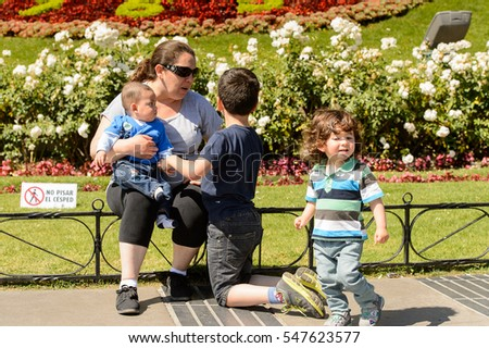 VINA DEL MAR, CHILE - NOV 9, 2014: Unidentified Chilean mother with two children in Vina del Mar. Chilean people are of mixed Spanish and Amerindian descent