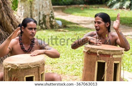 VINALES VALLEY,CUBA-JULY 8,2015: Taino Arawak Cuban indians culture recreated before entering the Cave of the Indian which is a major tourist attraction in the Unesco World Heritage Site.