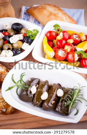 Vine leaves stuffed with peppers and Mediterranean antipasto, top view