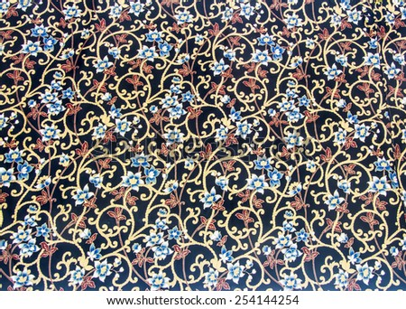 Vine with white blue flower and red leaf pattern.  Batik texture pattern in thai style - stock photo