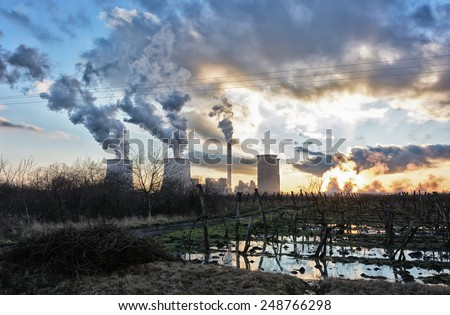 vineyards behind Power plant, beautiful sunset - stock photo