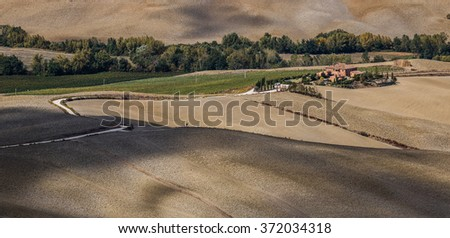 Vineyards, mansions and olive fields in rural Tuscany, Italy - stock photo