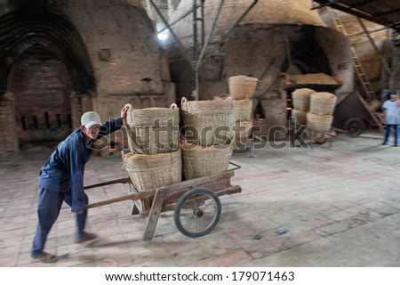 VINH LONG, VIETNAM - MARCH 7: Delivery of rice straw in a brickworks in the Mekong delta on March 7, 2009 near Vinh Long. Rice straw is used as fuel to heat the brick ovens.