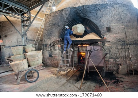 VINH LONG, VIETNAM - MARCH 7: Rice straw fuels a brickworks in the Mekong delta on March 7, 2009 near Vinh Long. The Mekong delta has become popular among tourists wishing to experience rural Vietnam.