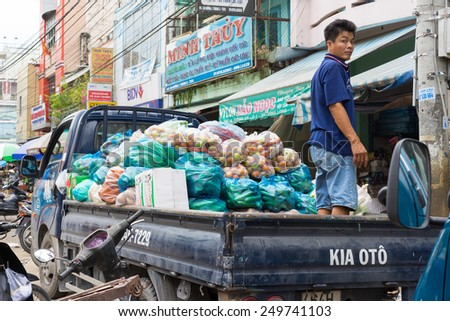 Vinh Long, Vietnam - Nov 30, 2014: Light deliver truck loaded full with tropical fruits at Vinh Long market, Mekong delta