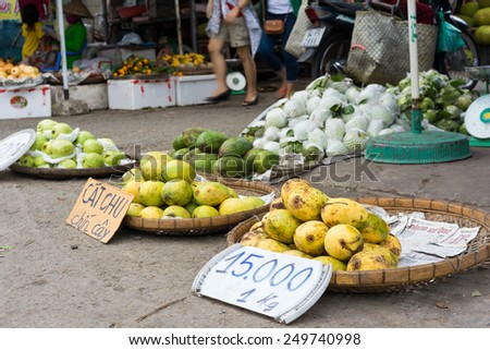 Vinh Long, Vietnam - Nov 30, 2014: Tropical fruits displayed on bamboo baskets at Vinh Long fruit market, Mekong delta. The price is surprisingly cheap