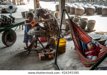 Vinh Long, Vietnam, September 27, 2015 the woman, traditional pottery, rural Vinh Long, Vietnam, the little ones