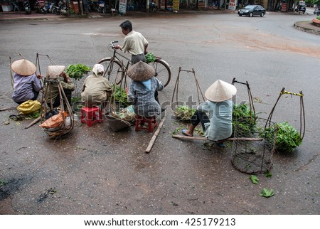 Vinh Phuc, Vietnam, May 23, 2016 farmers groups, rural Vinh Phuc, selling vegetables on the street.
