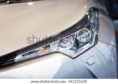 Vinnitsa, Ukraine - December 16, 2016.Toyota C-HR concept car.Auto headlights,Front of the car,front-side, logo Toyota, showroom.Presentation of the new model Toyota car - Toyota C-HR