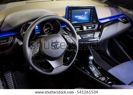 Vinnitsa, Ukraine - December 16, 2016.Toyota C-HR concept car.Inside the car,steering wheel,interior of the car, logo Toyota, showroom.Presentation of the new model Toyota car - Toyota C-HR