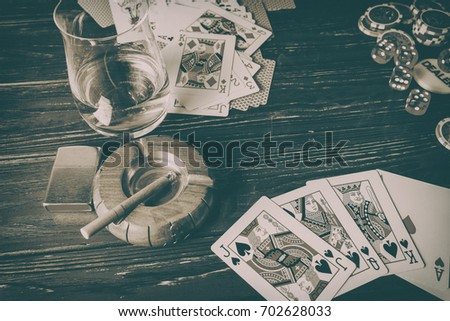 Vinnitsa, Ukraine - January 15 , 2017: Set to playing poker with cards and chips on wooden background