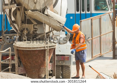 VINNITSA, UKRAINE - June 19, 2015: Pouring the concrete foundation of the building site shopping center down the street Sobornaya. June 19, 2015 in Vinnitsa, Ukraine.