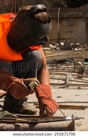 VINNITSA, UKRAINE - June 19, 2015: Welding work on the construction site shopping center down the street Sobornaya. June 19, 2015 in Vinnitsa, Ukraine. - stock photo