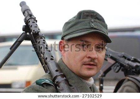 VINNITSA, UKRAINE - MAR 21: A member of history club called Red Star wears historical German uniform as he participates in a WWII reenactment in Vinnitsa, Ukraine on March 21, 2009.