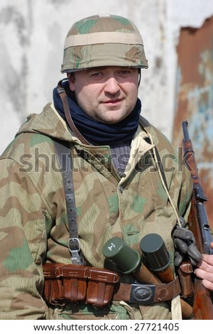 VINNITSA, UKRAINE - MAR 21: Member of a history club called Red Star wears a historical German uniform as he participates in a WWII reenactment in Vinnitsa, Ukraine on March 21, 2009.