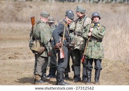 VINNITSA, UKRAINE - MAR 21: Members of a history club called Red Star wears a historical German uniform as he participates in a WWII reenactment in Vinnitsa, Ukraine on March 21, 2009.