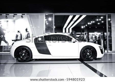 Vinnitsa, Ukraine - November 11, 2012. Audi R8 concept car. showroom.Presentation. Presentation of the new model Audi car -  R8.Front of the car,front-side, logo .Black and white autophoto